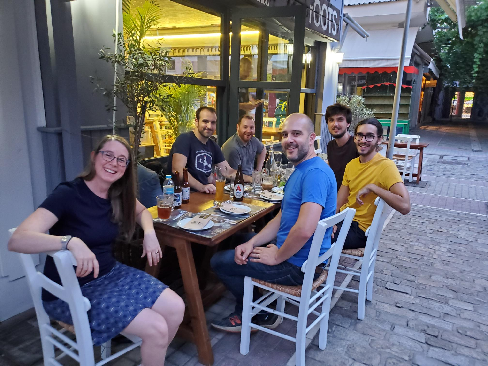 Heather, Adrien, Bob, François, Tobias and Julian sitting outside a restaurant