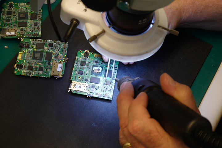 Hand replacing an Integrated Circuit (IC) to test